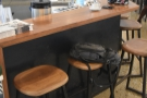 There's more seating if you go around behind the counter, starting with these three stools.