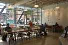 Finally, beyond the window-bar/communal table are two more benches along the far wall.