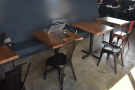 Another view of the tables in the middle. There is a power strip running under the bench.