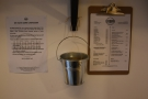 On the wall between the shelves, you'll find a note about going cashless, the sugar and...