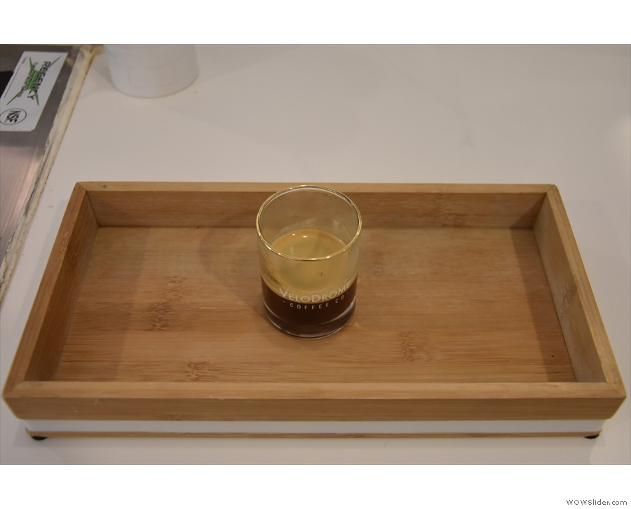 My espresso, served on a wooden tray. Normally there'd be a glass of soda water too.