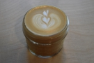 My cortado, in a lovely, small glass jar.