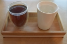 Like the espresso, it's served on a wooden tray, this time with my Therma Cup!