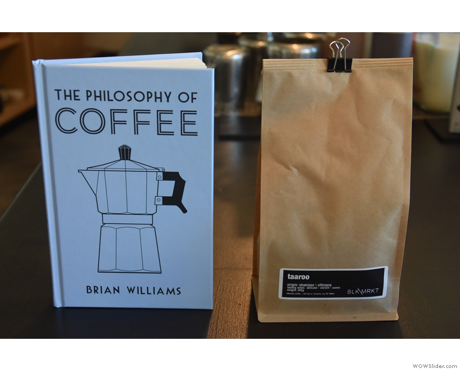A common theme on this trip: swapping coffee for copies of my book.