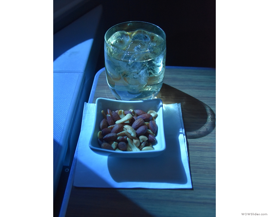 By now the cabin service had started, with (warm) nuts and a drink.