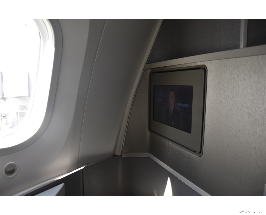 The TV is folded back for takeoff and landing...