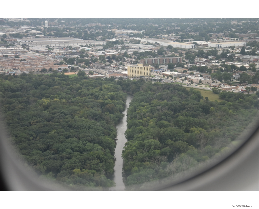 The Des Plaines River cuts right through the woods, running north to south.