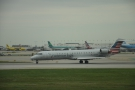 There are planes of all sizes, like this little American Airlines Bombardier CRJ-700...