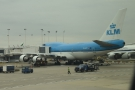 A KLM Boeing 747-400 is next door at Gate M8..