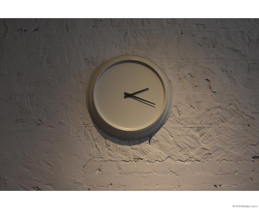 Minimalist clock on a minimalist wall.