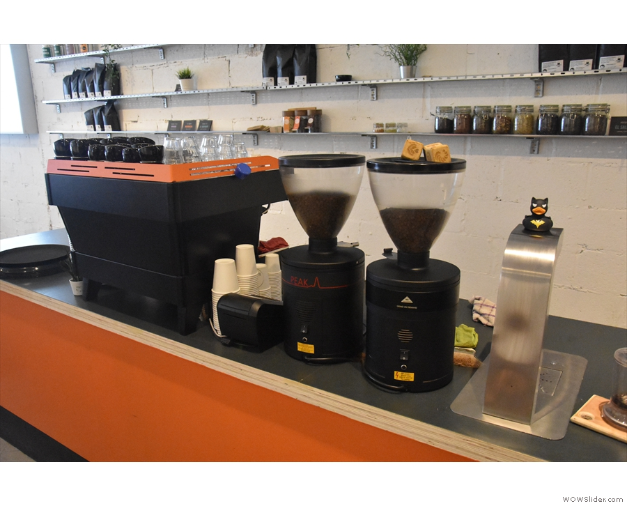 The coffee's made in the back part of the counter. Here's the espresso machine & grinders.
