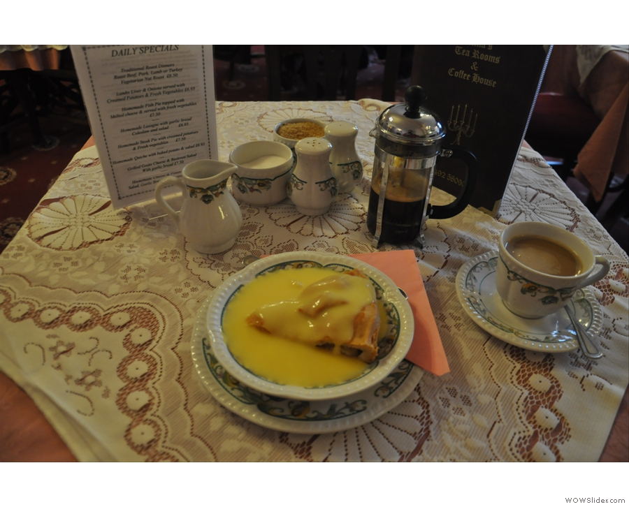 A caffetiere of coffee and apple pie, smoothered in custard. Home comforts at Anna's Tea Rooms, Conwy