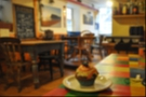 My cupcake surveys the warm, welcoming interior of Oystercatchers Cafe, Teignmouth