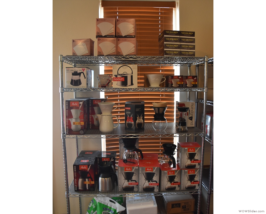 As well as coffee beans, there's a selection of kit to buy on shelves to the left of the door.