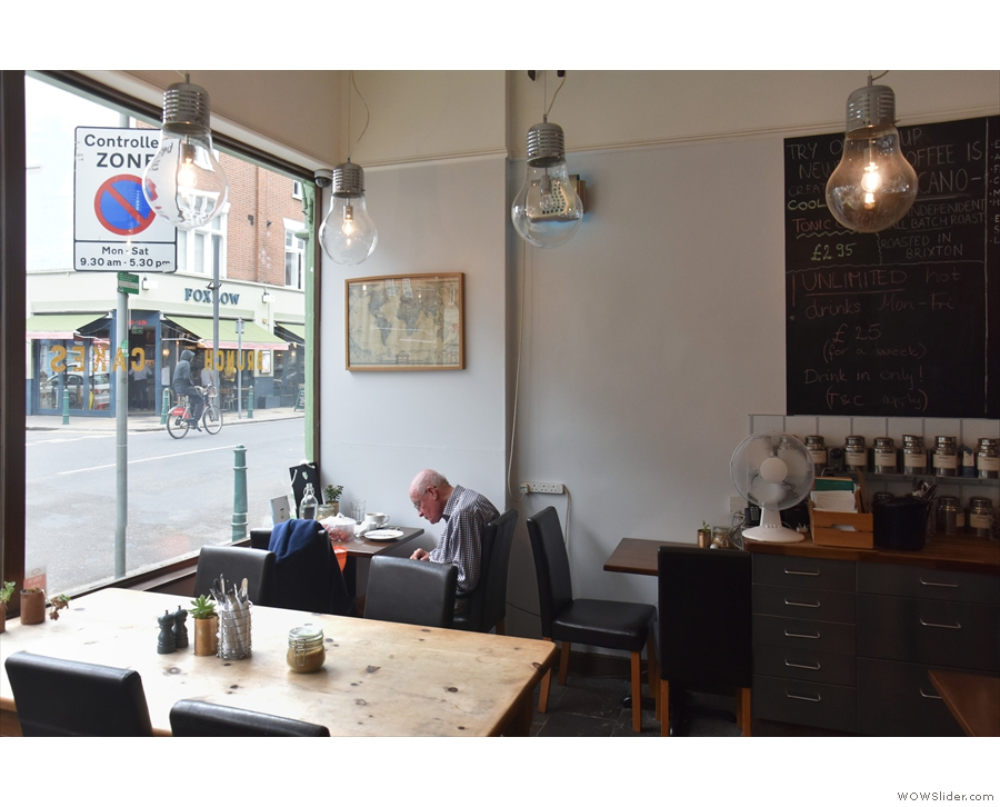 ... you'll find a two-person table by the window and another one beside the counter.