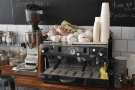 ... while the coffee is dispensed by this two-group La Marzocco Linea at the back.