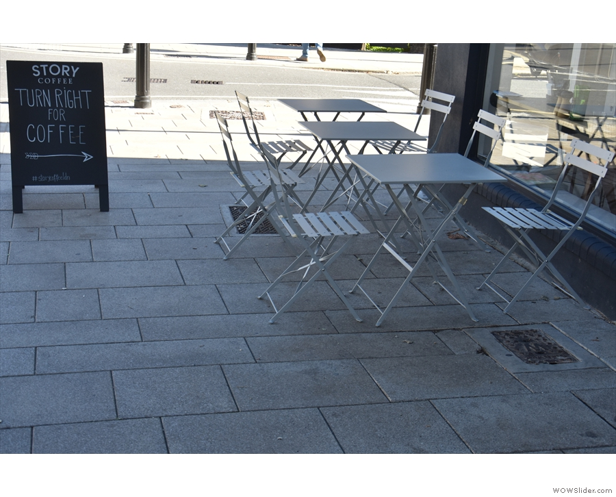 There's plenty of space on the well-shaded pavement for these three tables.