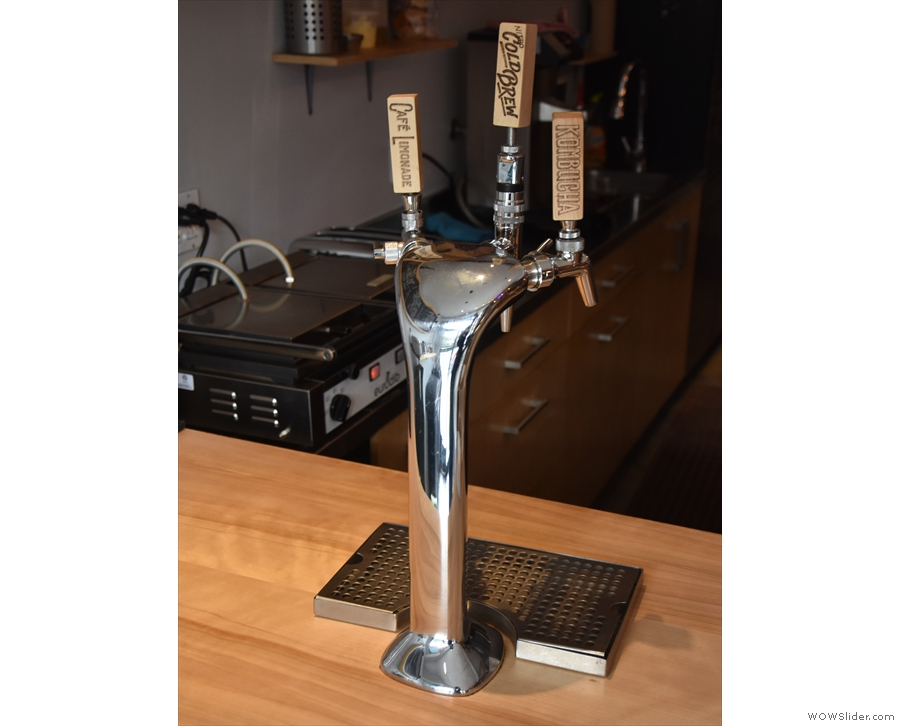 At the front is a three-headed beer tap, with various cold brew options.