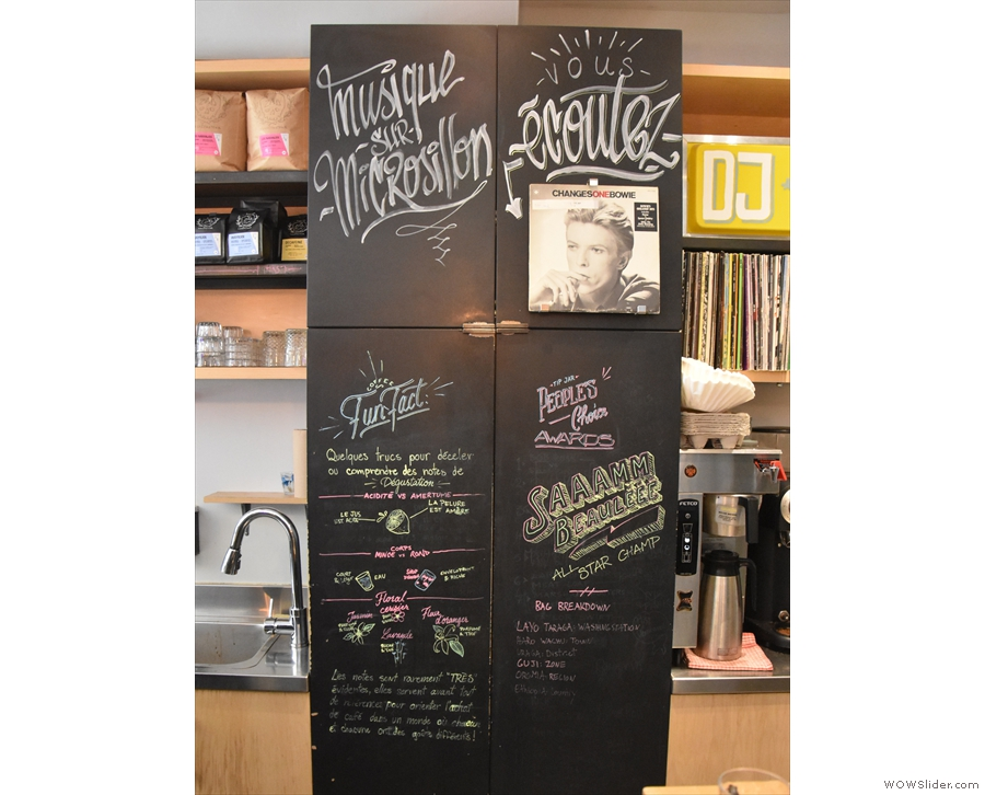 There are some notes about coffee on these blackboards at the far end of the counter...