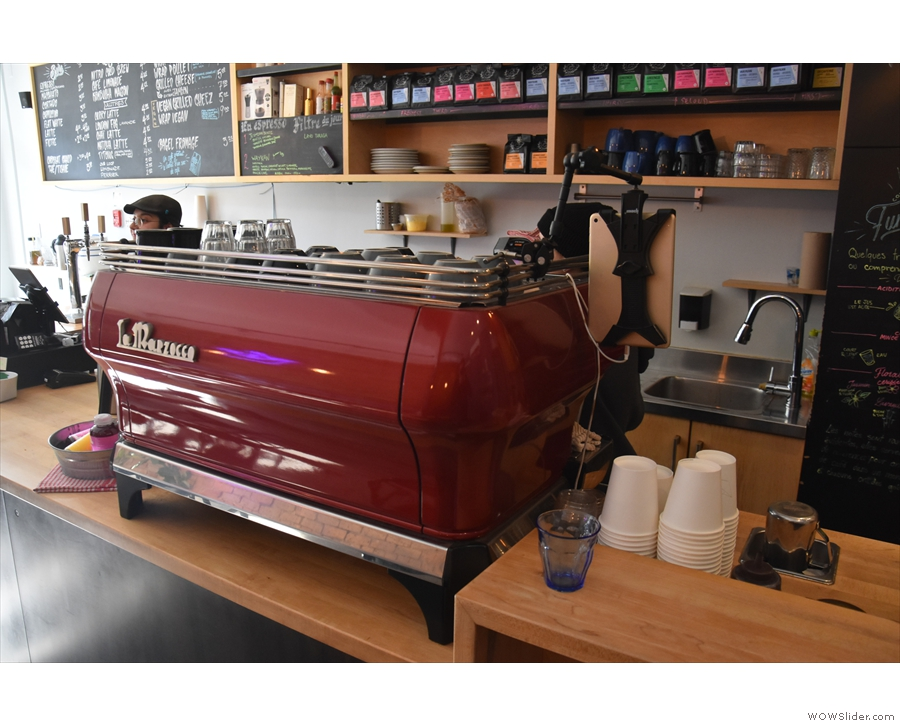 However, the lovely red La Marzocco GB5 espresso machine  is still there...