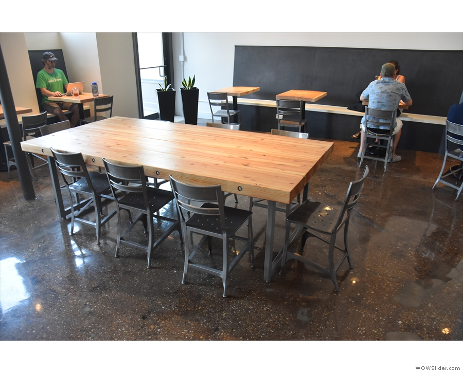 There's more seating, dominated by this central, communal table.