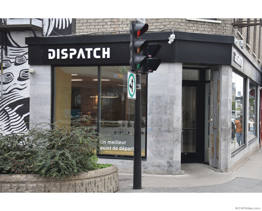 Dispatch is right on the corner, the door at 45⁰, flanked by windows.