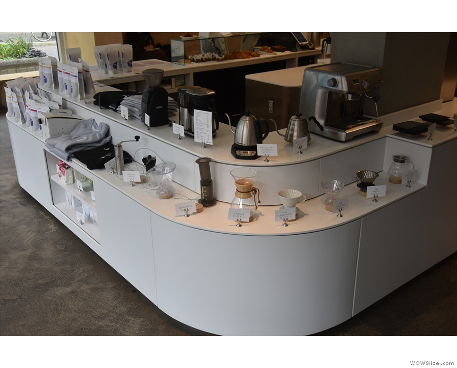 The counter doubles as retail shelving for all manner of coffee-making kit...