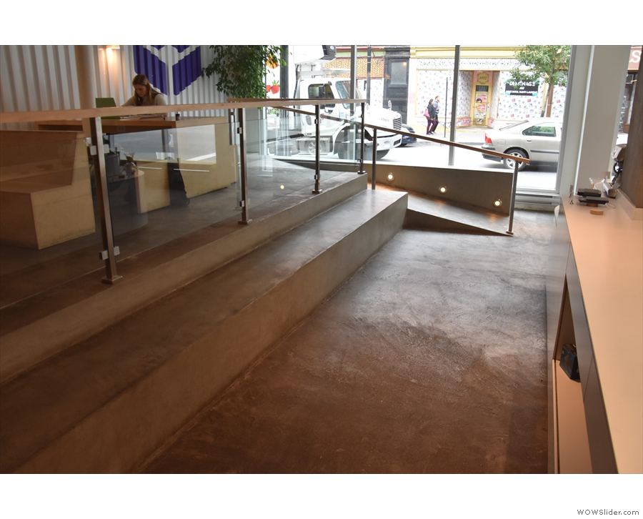 Finally, there's a long, concrete bench/step running along the front of the raised area.