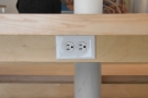 ... partly because of the neatly-placed power outlets under the lip of the table.