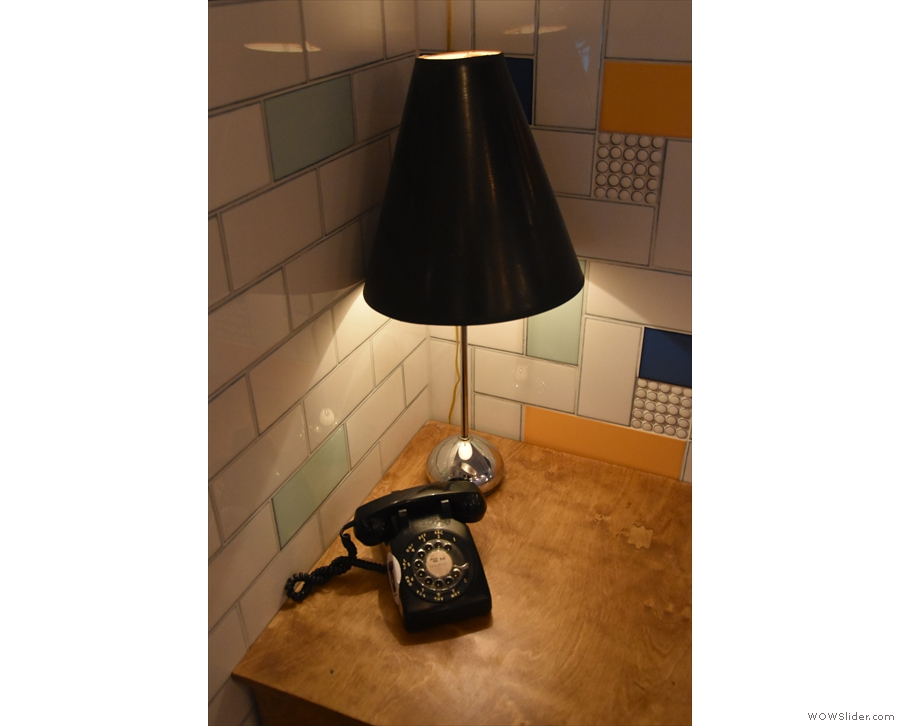 This one has a lamp and an old-fashioned rotary dial telephone.
