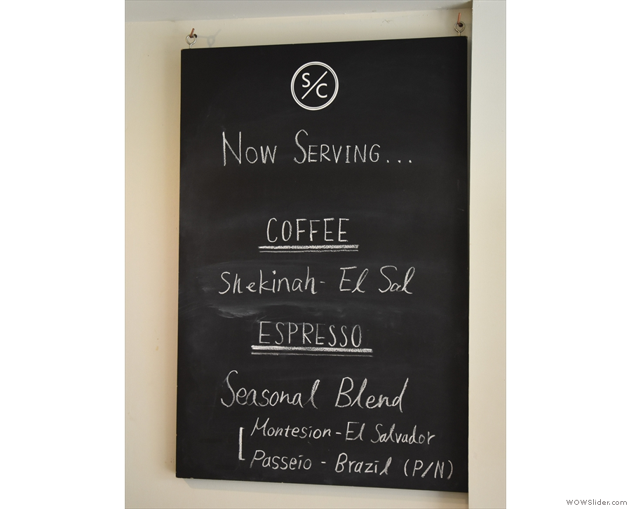 The coffee choices are chalked up on the board on the right-hand wall.