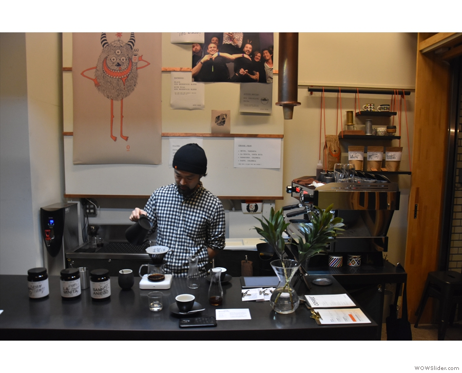 Barista and head-roaster, Yuuki, at work making pour-over at the counter.