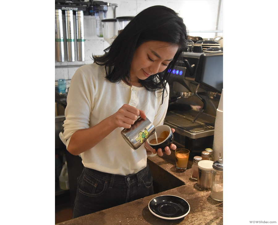 Down to business. This is Mizuki, one of the two baristas, pouring latte art.