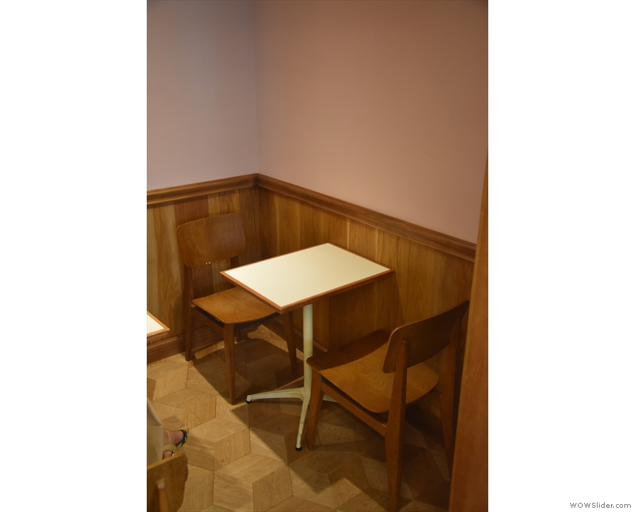 A small space runs the full width of the store, with two-person tables like this one.