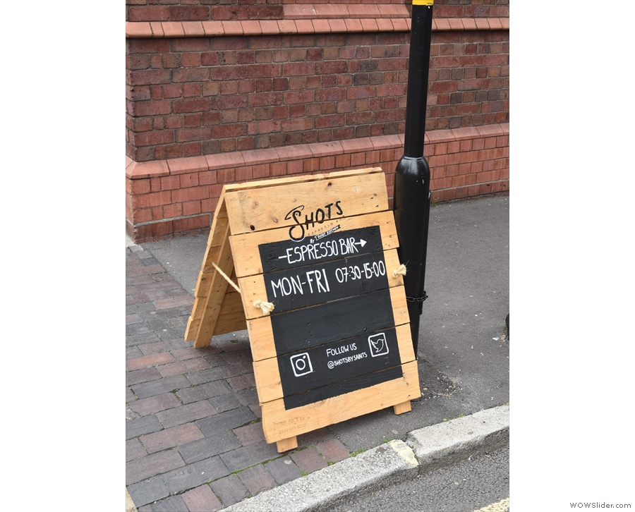 Now it's the home of SHOTS Espresso Bar, as this handy A-board at the end of the street...