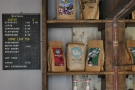During Upstairs Coffee days, the menu was on the back wall, next to some narrow shelves.