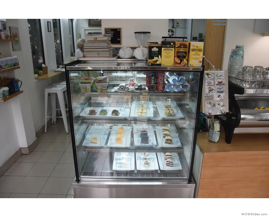 The display cabinet next to the counter holds the bakery's considerable cake output.