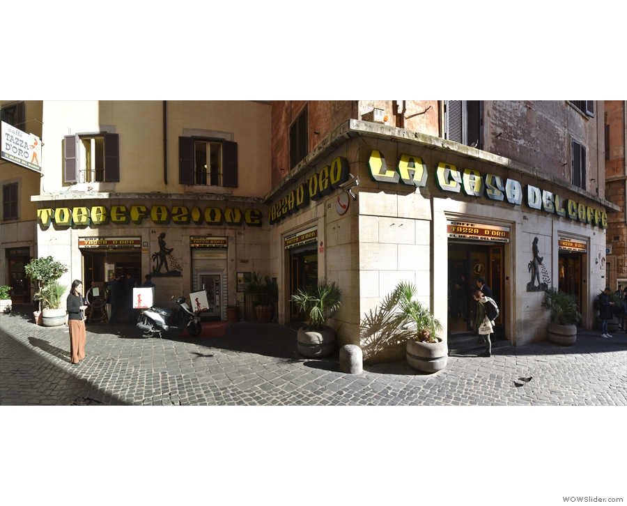 Tazza D'Oro, on the eastern side of a sunny street in Rome. It has an interesting...