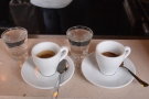 The end result: two espressos, each with a glass of water. On returning that evening...