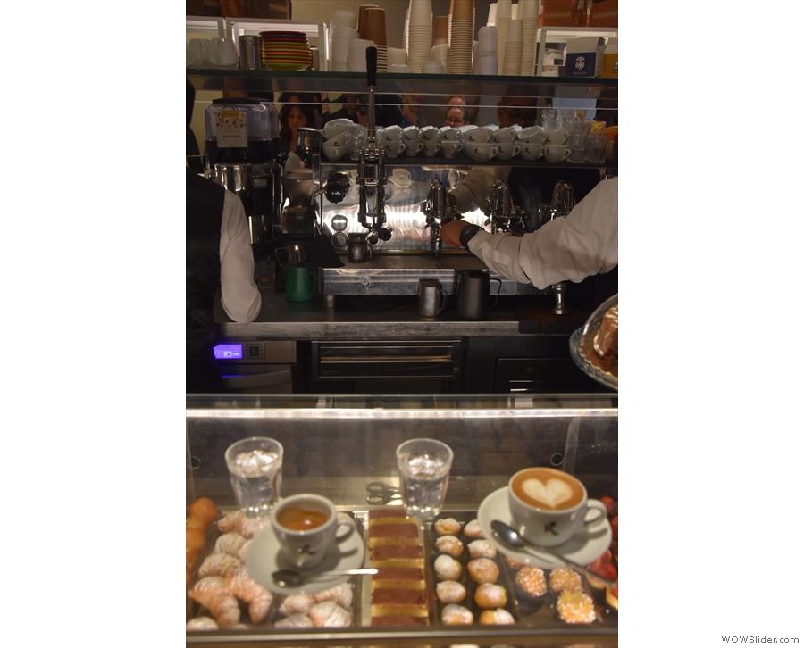 Here's our coffee, admiring the espresso machine.