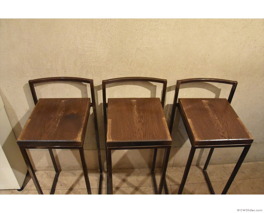 Typically you stand at the counter, but there are some bar chairs for those that want them.