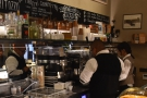 The coffee operation is at the front, behind the till...