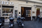 Blink and you might miss it: Roscioli Caffè's narrow entrance on Piazza Benedetto Cairoli.
