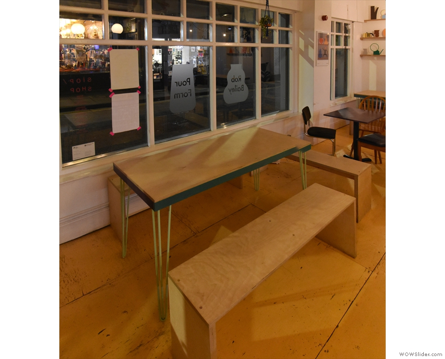 The view of the table as seen from inside the door beyond which...