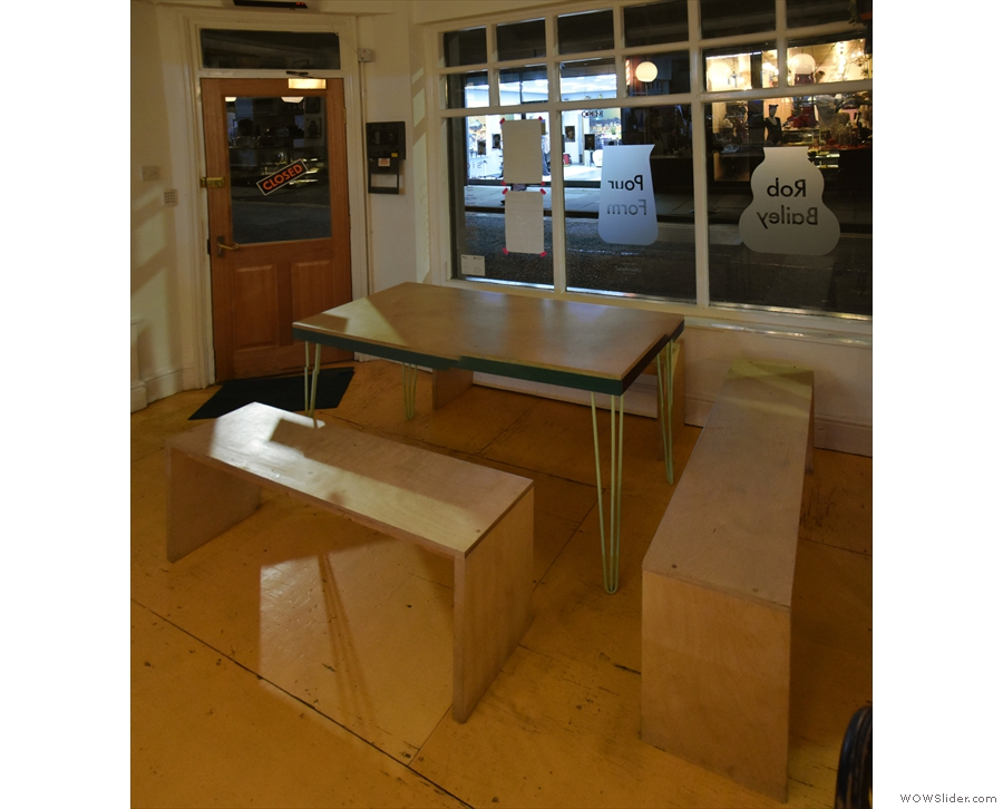 Meanwhile, to the left of the door is this communal table with benches.