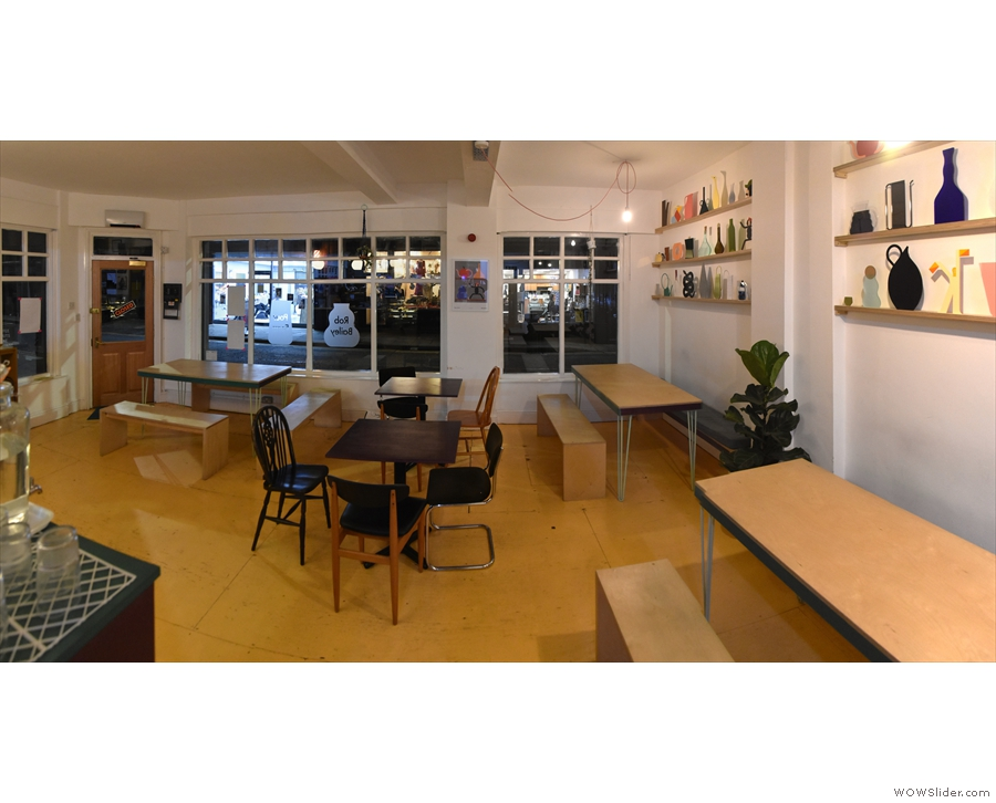 A panoramic view of the seating in the front half of Siop Shop from beside the counter.