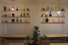 The left-hand wall, above the tables, has art displays which change every three months.