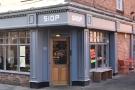 The door, on the corner, does not discriminate between Tib Street and Silver Jubilee Walk.