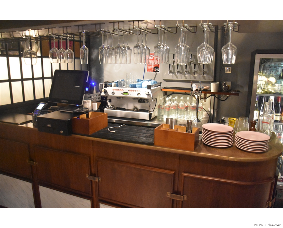 The basement has its own bar, including an espresso machine, on the left by the stairs.
