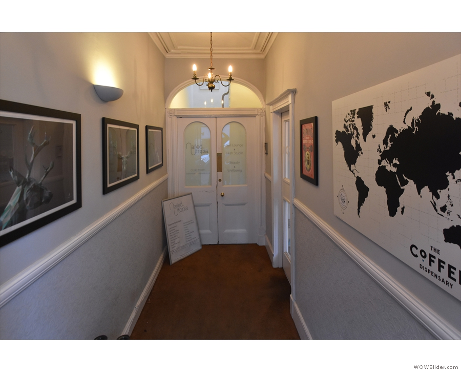 This leads to a long corridor lined with various pictures...